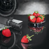 Still life with strawberry In search of darling. Imagination on a theme of search of the soulmate. The telescope and the map represent searches. Strawberry Royalty Free Stock Images