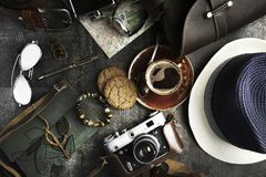 Still life in style of flat lay of travel items. Glasses, old film camera watch and other items of travel on the table royalty free stock images
