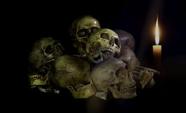 Still life style ;Skulls of bones with candle at night .Halloween day Stock Images