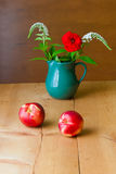 Still life with summer flowers and fruits Stock Photos