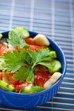Still life: summer salad on blue Stock Photos