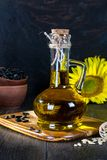Still life with sunflower oil in glass bottle, seed and sunflower royalty free stock photography