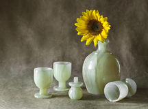 Still Life with Sunflowers. Jug and glasses Royalty Free Stock Photo