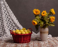 Still life of sunflowers and apples Stock Photos
