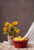 Still life of sunflowers and apples. At home Stock Image