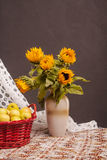 Still life of sunflowers and apples. At home Royalty Free Stock Photos