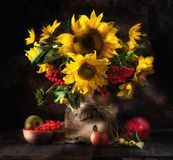 Still life with sunflowers, fruits and berries. Still life with sunflowers, fresh fruits, flowers and berries Royalty Free Stock Photography