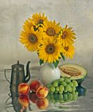 Still life with a sunflowers and fruits. Still life with a sunflowers in vase and different fruits Stock Image