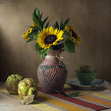 Still life with sunflowers and quince. On wooden table Royalty Free Stock Photos