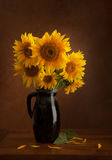 Still Life with Sunflowers. On wooden bckground Royalty Free Stock Images