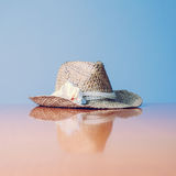 Still Life of Sunhat with Flower Accent Stock Photography