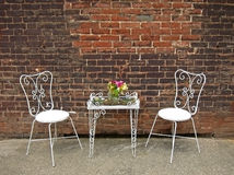 Still Life Table and Chairs Brick Wall Stock Images