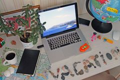 Still life on the table with a laptop and a stone inscription vacation stock images