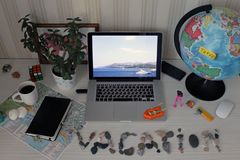 Still life on the table with a laptop and a stone inscription vacation royalty free stock image