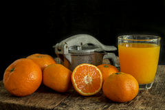 Still life tangerines and juicer Royalty Free Stock Photo