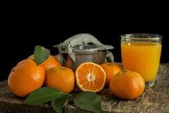 Still life tangerines and juicer. Still Life orange patterned on old wood and antique juicer Royalty Free Stock Photo