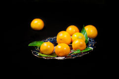Still life with tangerines on a plate Royalty Free Stock Photography