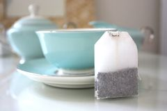 Still life of tea bag with tea service Royalty Free Stock Photography