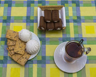 Still life with tea, biscuits and sweet chocolate straws Royalty Free Stock Photo