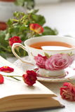 Still life with tea, books and roses Stock Photo