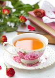 Still life with tea, books and roses Royalty Free Stock Images