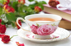 Still life with tea, books and roses Royalty Free Stock Photos