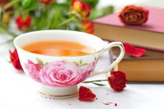 Still life with tea, books and roses Royalty Free Stock Photography
