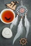 Still life with tea, crochet stone, dream catcher Royalty Free Stock Photography