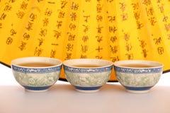 Still life of tea crockery and hand fan Royalty Free Stock Photos
