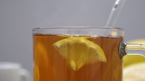 Still life of tea with lemon, tablets and thermometer, jam and berries. The concept of treating colds.  stock video footage