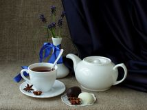 Still life with tea service and spring flowers Stock Image