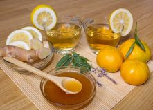 Still life. Tea in transparent cups. Honey, ginger, lemon. From cold and flu. royalty free stock photos