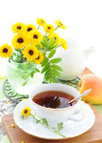 Still life with tea and yellow flowers Royalty Free Stock Image