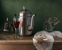 Still life with teapot and glass of red wine Royalty Free Stock Images