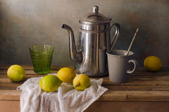 Still life with teapot and lemons Royalty Free Stock Image