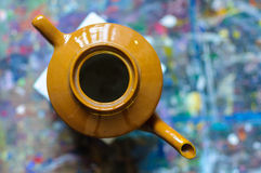 Still life teapot on white cube Stock Photo