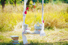 Still life with teddy bear on a swing Royalty Free Stock Photos