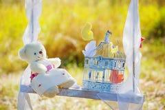 Still life with teddy bear on a swing Stock Photos