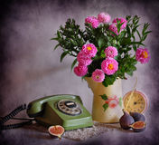 Still life with a telephone and flowers Stock Image