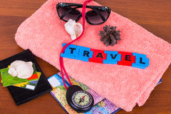 Still life on the theme of travel. Still life on the theme of the trip: towel, sunglasses,compass, shells,card,passport and credit cards Royalty Free Stock Photo