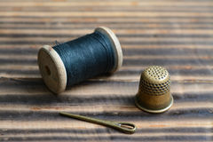 Still life with thread and thimble Stock Photo