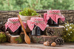 Still life with three jars of fruit jam and decoration Stock Image