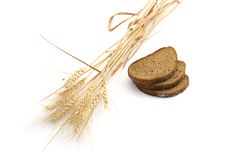 Still life three pieces of bread and linking of ears of wheat, i Stock Images