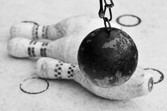 Still life with three russian skittles and one sphere. Black and white still life with three old Russian skittles and one sphere in rain Royalty Free Stock Photography
