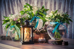 Still life with three wedding bouquets and candles Stock Photo