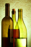 Still-life with three wine bottles Stock Photos