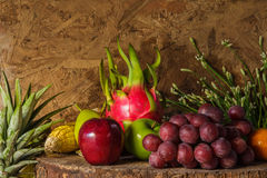 Still life with on the timber full of fruit. Royalty Free Stock Image