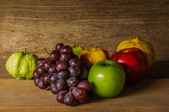 Still life with on the timber full of fruit Royalty Free Stock Image