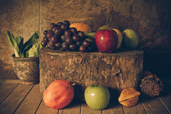 Still life with on the timber full of fruit Royalty Free Stock Photos