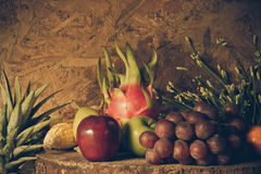 Still life with on the timber full of fruit. Stock Images